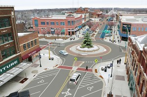 This rendering by a photo morphologist shows how the intersection of Broadway and Main Street could look if some changes are implemented, including a roundabout, two lanes of traffic with a turn lane in the center, angled parking on one side and bike lanes to name a few of the amenities. - Provided