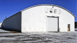 This white building at a farm in Wells, photographed in December, was the former site of POW barracks during World War II. Today, it houses farm machinery. — Jerome Meyer/for the Albert Lea Tribune