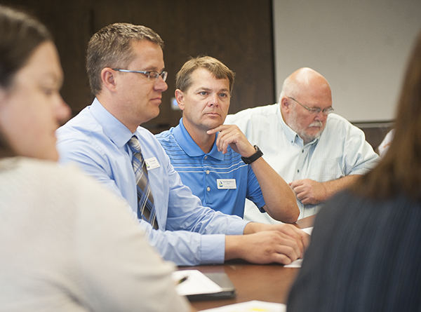 Albert Lea Mayor Vern Rasmussen Jr. listens during a group meeting to discuss local workforce challenges in the community Tuesday at City Hall. - Colleen Harrison/Albert Lea Tribune