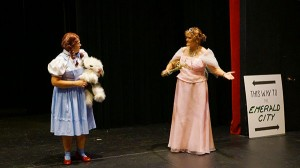 Dorothy, played by Lisa Sturtz, explains to the Good Witch of the North, played by Sue Jorgensen, that she's not a witch but a lost girl from Kansas. - Cathy Hay/Albert Lea Tribune