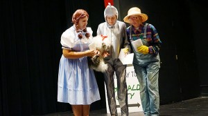 Dorothy (Lisa Sturtz), the Tin Man (Karen Hendrickson) and the Scarecrow (Roxanne Irons), accompanied by Toto, decide to brave the territory of the Wicked Witch of the West to reach Emerald City in pursuit of their dreams. - Cathy Hay/Albert Lea Tribune
