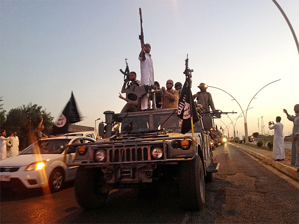 In this photo taken June 23, 2014, fighters from the Islamic State group parade in a commandeered Iraqi security forces armored vehicle down a main road at the northern city of Mosul, Iraq. Members of the Somali community say that more young people have joined ISIS, despite efforts to prevent terror recruiting here. — AP file 2014