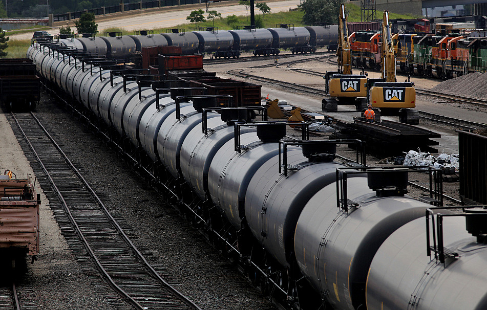A train carrying oil cars moves through the Burlington Northern Santa Fe rail yard in Minneapolis, July 30, 2014. - Jeffrey Thompson/MPR News 2014
