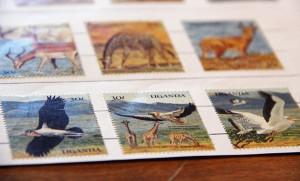 These Uganda stamps show images of wildlife. - Sarah Stultz/Albert Lea Tribune