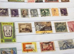These stamps in Bill Sturtz's collection are from Iraq. - Sarah Stultz/Albert Lea Tribune
