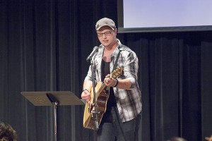 Jake Friedrich sang and played guitar to an original song Friday night during Recovery's Got Talent at Crossroads Church. - Hannah Dillon/Albert Lea Tribune