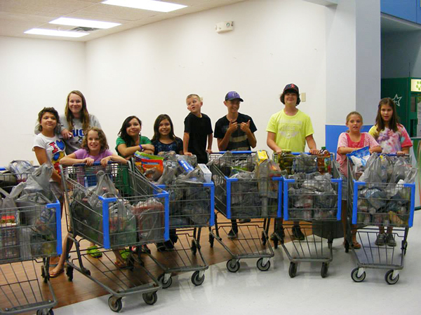 "Through the ""Thanks a Ton"" food campaign at Ascension Lutheran Church, Ascension youth were able to donate $900 for food for the local Salvation Army food shelf.  The group's goal is to donate over 2,000 pounds of food by Rally Sunday. - Provided"