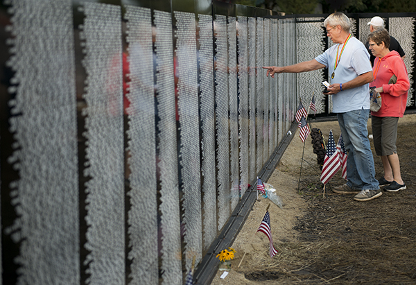 The Vietnam traveling memorial wall was set up at Heritage Park in Forest City, Iowa, over the weekend as a part of Operation LZ — a welcome home event for Vietnam War veterans. The wall is a 3/5 scale of the Vietnam Memorial in Washington, D.C., and is about 6 feet tall and 300 feet from end to end. -Colleen Harrison/Albert Lea Tribune