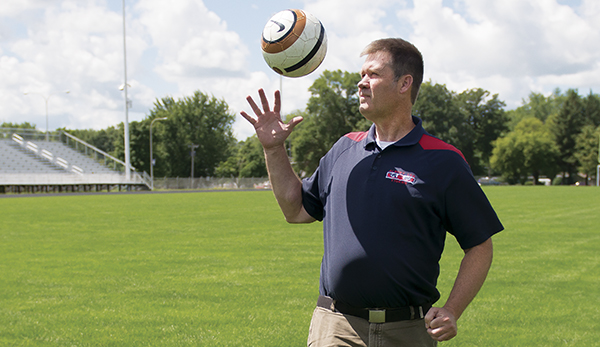 Albert Lea boys' soccer coach Bob Furland stands on Jim Gustafson Field. In Furland's first season leading the program, the Tigers have a 1-0-1 overall record. - Colleen Harrison/Albert Lea Tribune