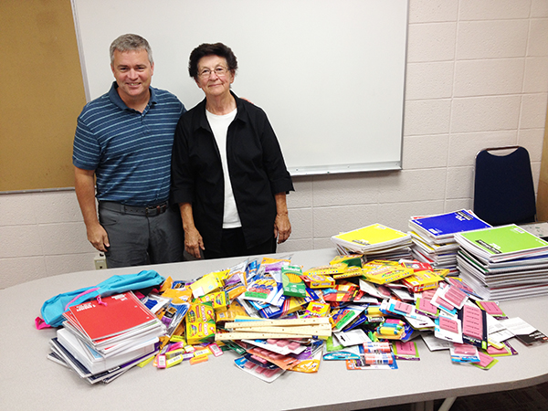 Superintendent Mike Funk accepts a donation of school supplies from Trinity Lutheran Church. Jean Pestorious brought the donations to the school. - Provided