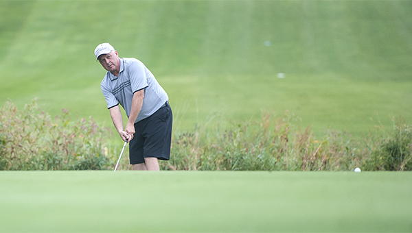 Ross Peterson chips the ball onto the green on the 17th hole Sunday on Day 2 of the Shortstop Tournament at Green Lea Golf Course. — Micah Bader/Albert Lea Tribune