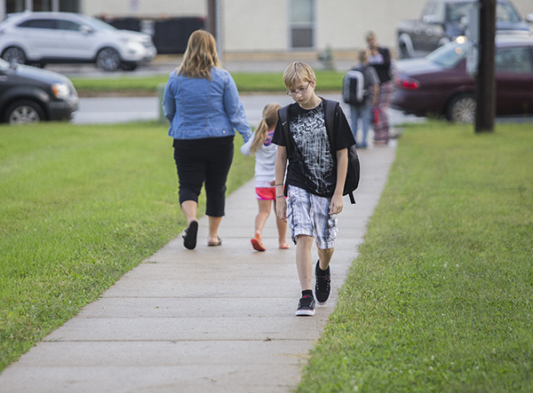 Students arrive at Sibley Elementary School this morning for the first day of school. - Colleen Harrison/Albert Lea Tribune