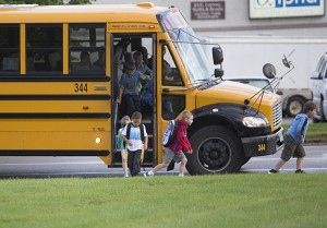 One of the first buses arrives to drop students off for the first day of school this morning at Sibley Elementary School. - Colleen Harrison/Albert Lea Tribune
