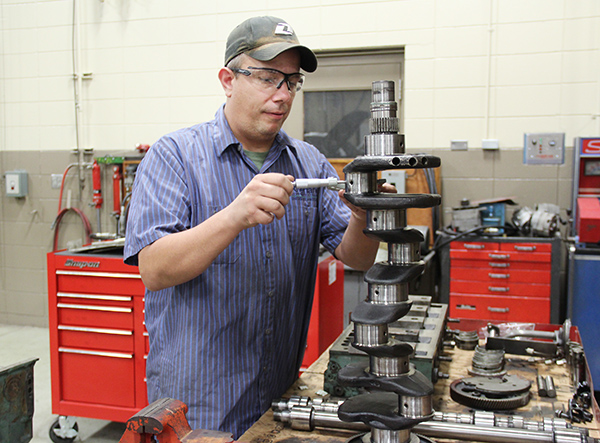 Riverland Community College student Robert Allen of Glenville works on rebuilding a small diesel engine on Wednesday at the school. After the motor is built, he plans to put it in a pickup. - Sarah Stultz/Albert Lea Tribune