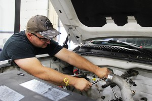 Riverland Community College student Jason Saltou works on a Duramax diesel to install head gaskets on Wednesday at the college. Sarah Stultz/Albert Lea Tribune