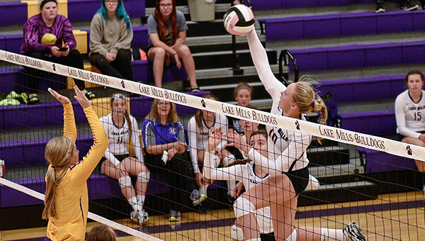 Lexi Groe of Lake Mills spikes the ball Thursday against Eagle Grove at Lake Mills. — Lory Groe/For the Albert Lea Tribune