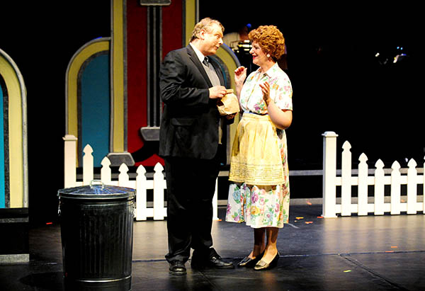 """Marion Cunningham, played by Diane Heaney, makes sure her husband, Howard, played by Keith George, has his sack lunch before he leaves for work in a production of """"Happy Days"""" in July 2013. Heaney will sing a song from """"Happy Days"""" in """"Golden Gala: On Stage"""" on Saturday. - Brandi Hagen/Albert Lea Tribune"""