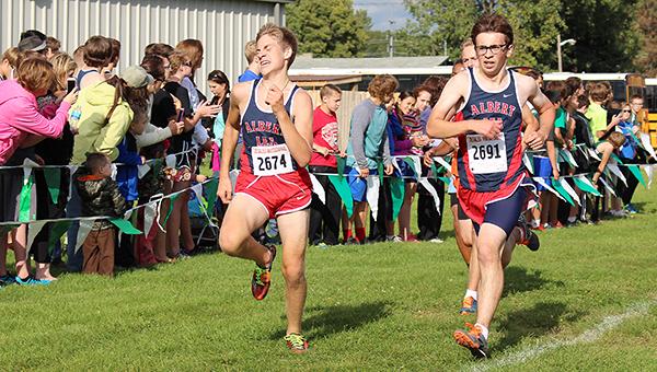 Nikk Christianson, left, and Herbie Lein of the Albert Lea cross country team compete Friday at Faribault. — Kathie Lein/For the Albert Lea Tribune
