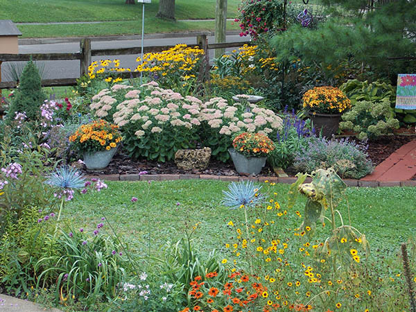 The September gardens are filled with color from mums, sedum and rudbeckia, adding to the joy of visiting the gardens. - Carol Hegel Lang/Albert Lea Tribune