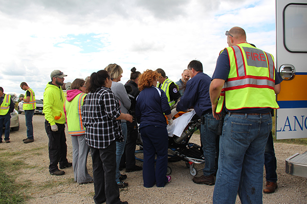 A 96-year-old woman is lifted into an ambulance with the help of first responders and volunteers. — Sam Wilmes/Albert Lea Tribune