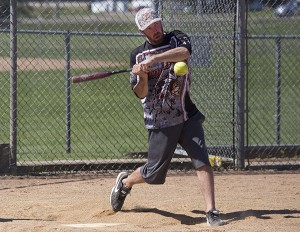 Ryan Bakke bats during the eighth annual Ryan Truesdell Memorial Softball Tournament Sunday at Snyder Field. - Colleen Harrsion/Albert Lea Tribune