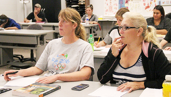 Riverland Community College students take part in a basic math course on Wednesday at the college. The college and Adult Basic Education are collaborating to help students who need a refresher in math. - Sarah Stultz/Albert Lea Tribune
