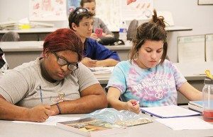 Riverland Community College student Ashonte Cofield of Albert Lea, left, works on math problems during a basic math class on Wednesday at the college. - Sarah Stultz/Albert Lea Tribune