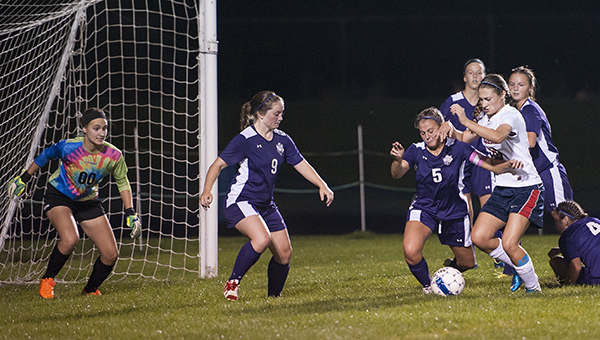 Turena Schultz of Albert Lea looks to score as she is defended by Northfield's Hannah Barlow, left, and Mackenzie Irwin Thursday at Jim Gustafson Field. — Micah Bader/Albert Lea Tribune