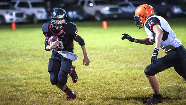 Alden-Conger quarterback Kaleb Bendickson tries to turn the corner as Lanesboro's Chris Freese attempts to keep him contained Friday on Homecoming at Alden. — Micah Bader/Albert Lea Tribune