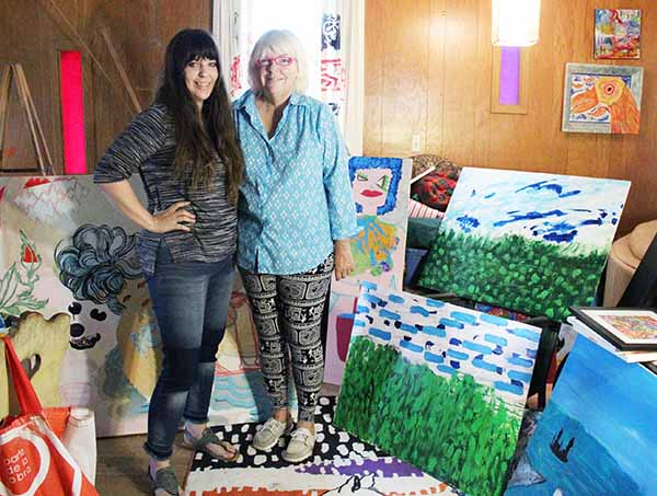 Rachel Bailey Collier and her mother, Carli Marticia Bailey, stand with some of their art that will be on display at the Albert Lea Art Center. - Sarah Stultz/Albert Lea Tribune