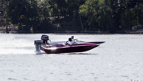 Boats race Saturday on Edgewater Bay during the Upper Midwest Power Boat Association's drag racing event. Colleen Harrison/Albert Lea Tribune