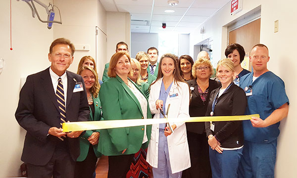 The Albert Lea-Freeborn County Chamber of Commerce Ambassadors celebrate the arrival of a new MRI machine at Mayo Clinic Health System in Albert Lea. -Provided