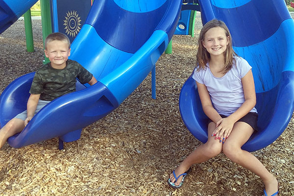 Blake and Clara Chapek recently won Albert Lea Parks and Recreation's Passport to the Parks contest.  Participants were asked to visit 15 or more city parks during the summer months and take their picture next to a distinguishing park feature. They then submitted the photos and were randomly drawn to win a fun basket.  - Provided