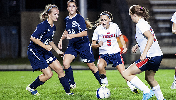 Claire Sherman, middle right, and Ashley Butt look to move the ball forward Thursday against Rochester Century at Jim Gustafson Field. — Micah Bader/Albert Lea Tribune