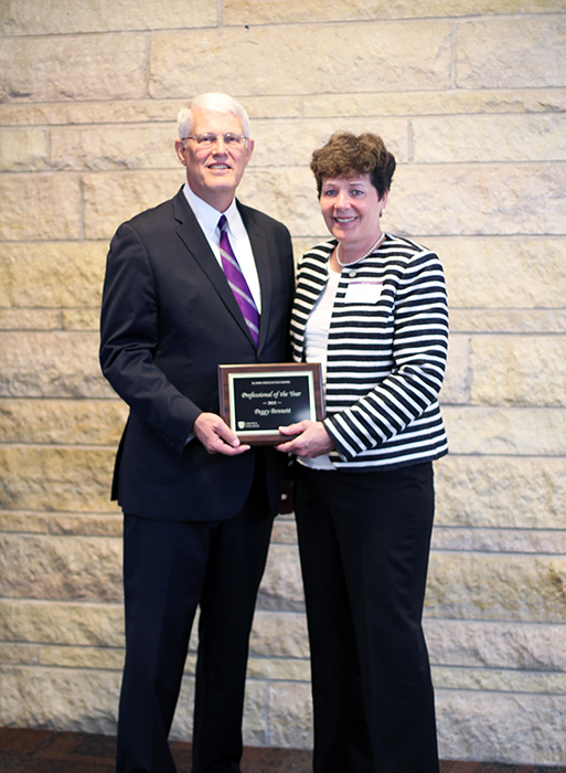District 27A Rep. Peggy Bennett, R-Albert Lea, was presented with the 2015 Professional of the Year award at the Crown College alumni awards banquet Friday in St. Bonifacius. The award is given to alumni in recognition of outstanding professional achievement and leadership and is selected by the Crown College Alumni Association Executive Committee. Bennett is pictured with Crown College President  Joel Wiggins. Bennett was recognized at the ceremony for winning the 2011 Albert Lea Area Schools Teacher of the Year Award, being a Minnesota state semifinalist for Teacher of the Year in 2012 and for her election to the Minnesota House of Representatives in 2014. Bennett graduated with a Bachelor of Science degree in education in 1980. — Provided