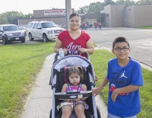 Irene Lopez, daughter, Jareli, 2, and son, Diego, 8, a third-grader at Halverson, participate in the walkathon Friday. — Sam Wilmes/Albert Lea Tribune