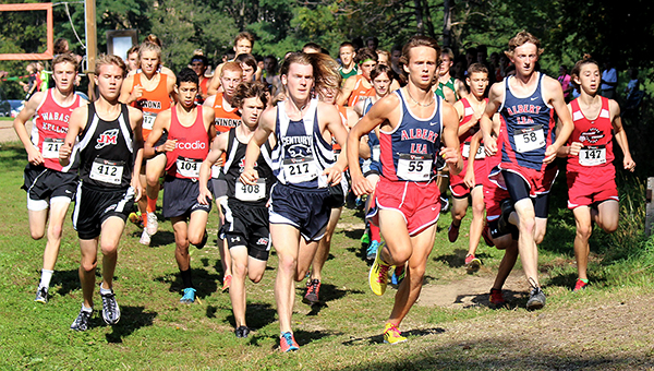 Albert Lea's Jackson Goodell, middle, and Jay Skaar, right, compete Saturday at the Jim Flim Invitational at Winona. — Kathie Lein/For the Albert Lea Tribune