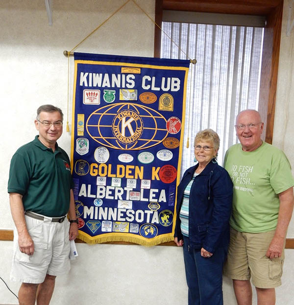 Golden K1 president Tom Knudtson welcomes new members Patty and Doug Christopherson. -Provided