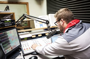 Mitchell Widmeier, the new sports director at KATE radio, adjusts the mixing board Tuesday at the studio. Widmeier has experience at multiple radio stations, including ESPN affiliate KJOC 93.5 FM in Iowa's Quad Cites. - Micah Bader/Albert Lea Tribune