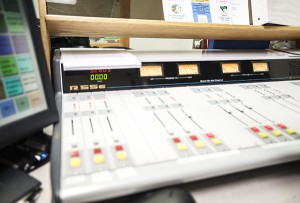 Needles move on the mixing board Tuesday at KATE radio in Albert Lea. - Micah Bader/Albert Lea Tribune