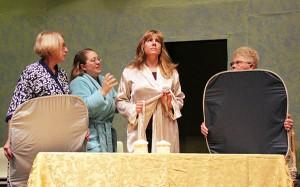 "Teresa Wilson, center, prepares to have her photo taken in ""Calendar Girls,"" a production by Albert Lea Community Theatre with Karen Szymanowski, Kris Bartley and Joanne Fox. - Sarah Stultz/Albert Lea Tribune"