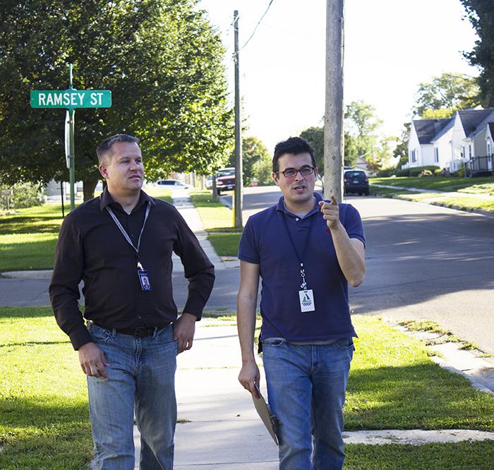 Adams and Gabrielatos walk down Ulstad Avenue Friday afternoon. — Sam Wilmes/Albert Lea Tribune