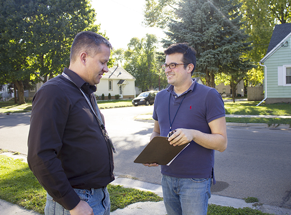 City Manager Chad Adams and Assistant City Manager Jerry Gabrielatos discuss their door-to-door effort Friday afternoon on Ulstad Avenue. — Sam Wilmes/Albert Lea Tribune