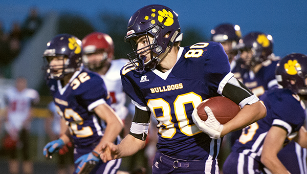 Grant Boehmer of Lake Mills runs after making a reception Friday against Pocahontas Area on Homecoming at Lake Mills. — Micah Bader/Albert Lea Tribune