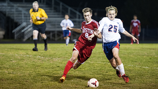 Albert Lea's Spencer Indrelie, right, battles for the ball with Austin's Ryan Kempen Tuesday on Senior Night at Jim Gustafson Field. — Micah Bader/Albert Lea Tribune