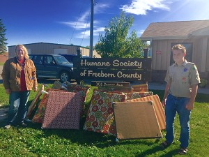 Colin Laurie donated the 20 dog beds he constructed to Christa DeBoer and the Humane Society of Freeborn County on Friday. -Provided