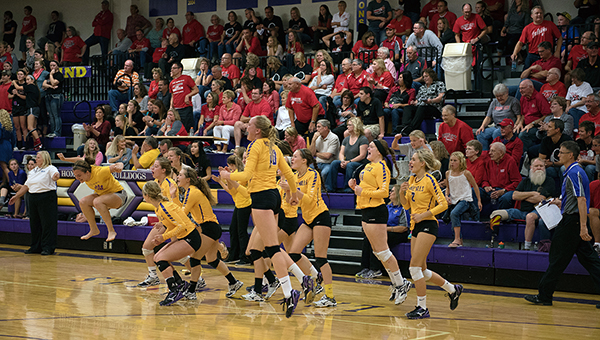 The No. 9 (2A) Lake Mills volleyball team celebrates a win Tuesday over No. 7 (3A) Forest City at Lake Mills. — Lory Groe/For the Albert Lea Tribune
