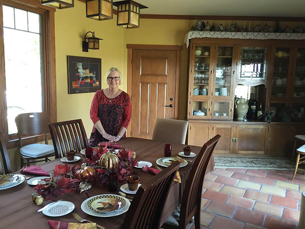 Katherine Pacovsky, co-owner of the The Czech Inn in Hayward, serves guests breakfast daily in the dining room of her establishment. - Kelly Wassenberg/Albert Lea Tribune