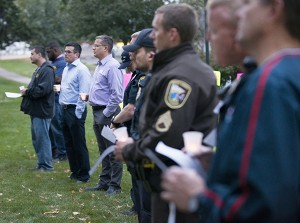 Members of the Freeborn County Sheriff's Office, Albert Lea Police Department and Albert Lea Fire Department, as well as Albert Lea City Manager Chad Adams, Assistant City Manager Jerry Gabrielatos and Mayor Vern Rasmussen Jr. were among those in attendance during a domestic violence awareness community candlelight vigil Thursday at New Denmark Park. - Colleen Harrison/Albert Lea Tribune