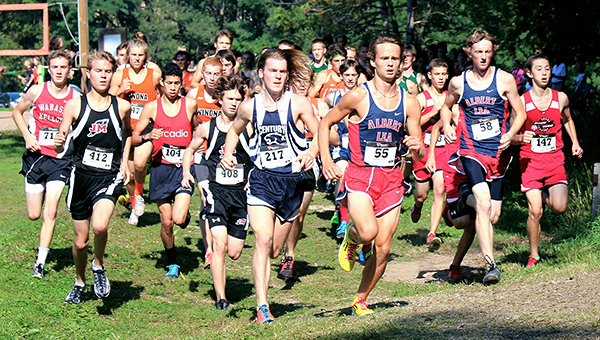 Albert Lea's Jackson Goodell, with bib No. 55, leads the pack at the Jim Flim Invitational Sept. 26 at Winona. Goodell led the Tigers to their highest finish, third place, in 19 years of competing at the meet. — Kathie Lein/For the Albert Lea Tribune
